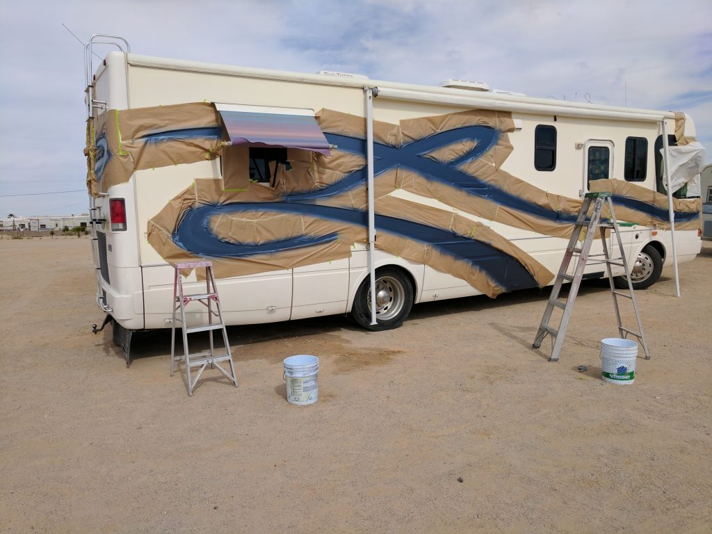 Workers painting RV
