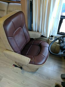 Driver side captain's chair in chocolate brown and tan leather